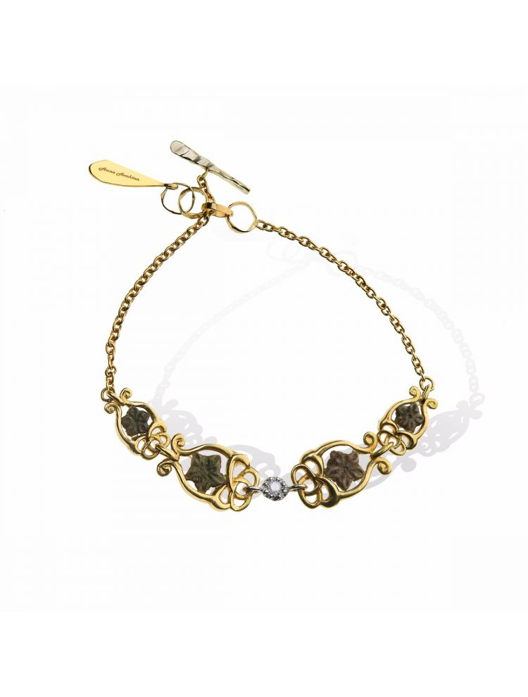 Anna Avakian gold bracelet with star stones