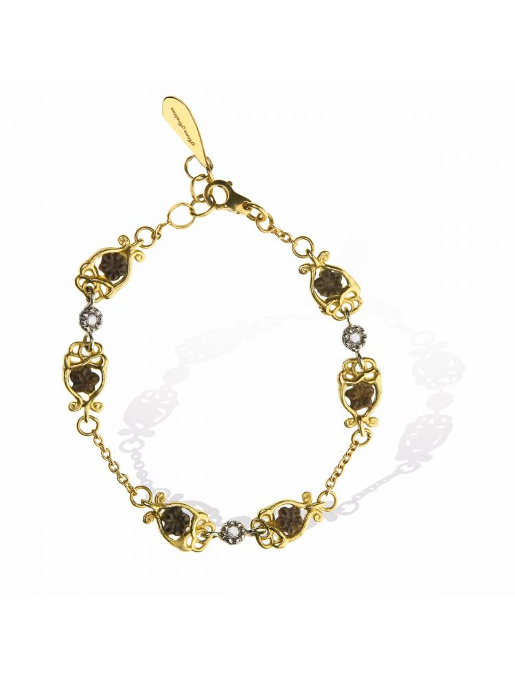 Anna Avakian gold bracelet with star stones and diamonds